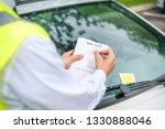 parking officer writing parking ... | Shutterstock . vector #1330888046