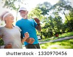 senior woman and man running... | Shutterstock . vector #1330970456