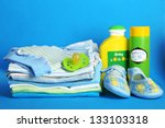 pile of baby clothes on blue... | Shutterstock . vector #133103318