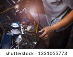 mechanic repairing a car check... | Shutterstock . vector #1331055773