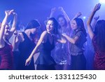 Stock photo beautiful young women dancing in night club 1331125430