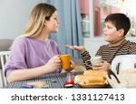 portrait of young woman and son ... | Shutterstock . vector #1331127413