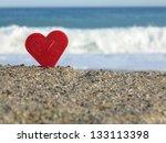 Red Heart On White Sand Beach