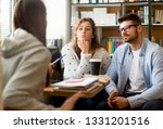 students learning together | Shutterstock . vector #1331201516