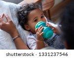 mixed race baby girl lying down ... | Shutterstock . vector #1331237546