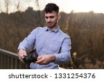 young business man looking at...   Shutterstock . vector #1331254376