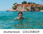 young pretty woman swimming in...   Shutterstock . vector #1331358029
