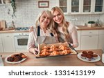 senior woman and her attractive ... | Shutterstock . vector #1331413199