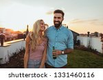 couple having lovely time at... | Shutterstock . vector #1331460116