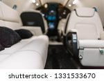 Business jet aircraft interior with leather comfortable seats and sofa - stock photo