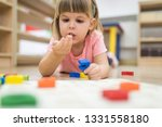 little caucasian girl learning... | Shutterstock . vector #1331558180