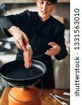 overhead shot of chef preparing ...   Shutterstock . vector #1331563010