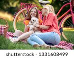 happy young mother with her... | Shutterstock . vector #1331608499