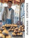unidentified man sells baked... | Shutterstock . vector #1331694563