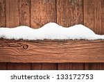 Snow On A Wooden Fence As A...