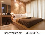 Stock photo bedroom decorated with wood and warm light 133183160