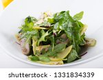 green arugula salad with beef... | Shutterstock . vector #1331834339