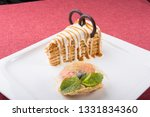 piece of honey cake served with ... | Shutterstock . vector #1331834360