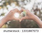 female hands heart shape on... | Shutterstock . vector #1331887073