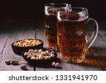 two mugs of lager beer and...   Shutterstock . vector #1331941970