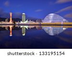 Kobe, Japan panorama at Port of Kobe with natural puddle reflection. - stock photo