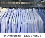row of different shirts in shop  | Shutterstock . vector #1331975576