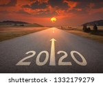 Small photo of Driving on idyllic open road against the setting sun forward to upcoming 2020 new year. Concept for success and future.