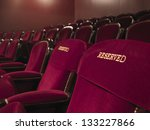 Two Red Reserved Theater Seats...