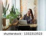 young woman with laptop in cafe | Shutterstock . vector #1332313523
