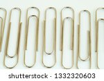shiny metal paper clips on a... | Shutterstock . vector #1332320603