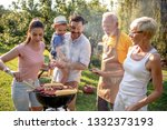 family having a barbecue party  ... | Shutterstock . vector #1332373193