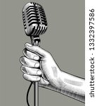 hand with a retro microphone.... | Shutterstock .eps vector #1332397586
