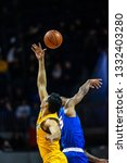 during a ncaa basketball game... | Shutterstock . vector #1332403280