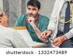 male doctor team talking to...   Shutterstock . vector #1332473489