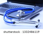 workplace of doctor with laptop ... | Shutterstock . vector #1332486119