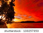 Red Sunset Sky Over The River...