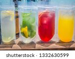 tasty fruits and juice | Shutterstock . vector #1332630599