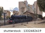 An Antique Locomotive And...