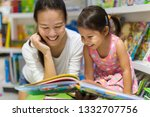 parent and child reading books... | Shutterstock . vector #1332707756