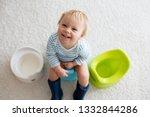 cute toddler boy  potty... | Shutterstock . vector #1332844286