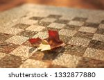 an autumn colored leave on a... | Shutterstock . vector #1332877880