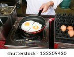 a chef is cooking sunny side up ... | Shutterstock . vector #133309430