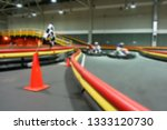 indoor kart racing on the go... | Shutterstock . vector #1333120730