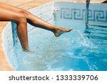 tanned legs of a woman enjoying ... | Shutterstock . vector #1333339706
