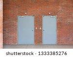 metal doors on orange brick...   Shutterstock . vector #1333385276