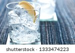 a lemon and ice in a glass of... | Shutterstock . vector #1333474223