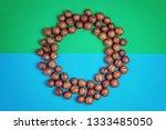 macadamia nuts pattern on blue... | Shutterstock . vector #1333485050