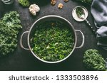 stewed kale in cooking pot on... | Shutterstock . vector #1333503896