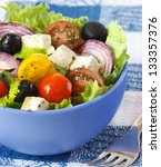 delicious greek salad for... | Shutterstock . vector #133357376