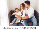 little boy sitting near parents.... | Shutterstock . vector #1333575533